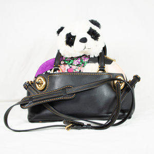 Like new Coach 'Outlaw' SE patchwork satchel